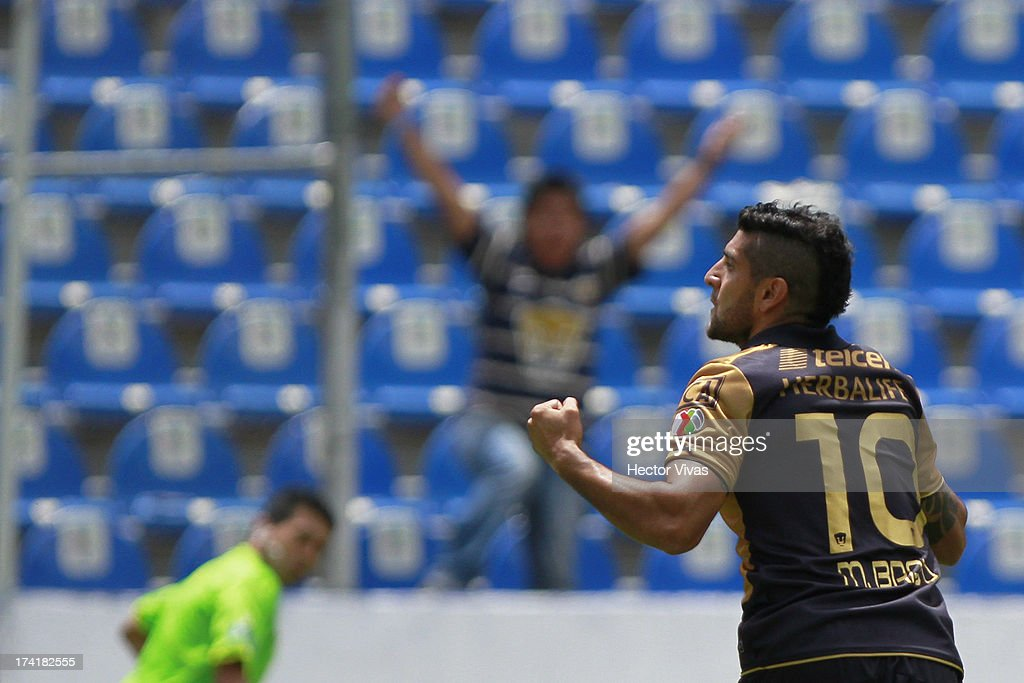 Omar Bravo of Pumas celebrates a goal against Puebla during a match between Pumas and Puebla as part of the Torneo Apertura 2013 Liga Mx at Cuauhtemoc Stadium on July 21, 2013 in Puebla, Mexico.