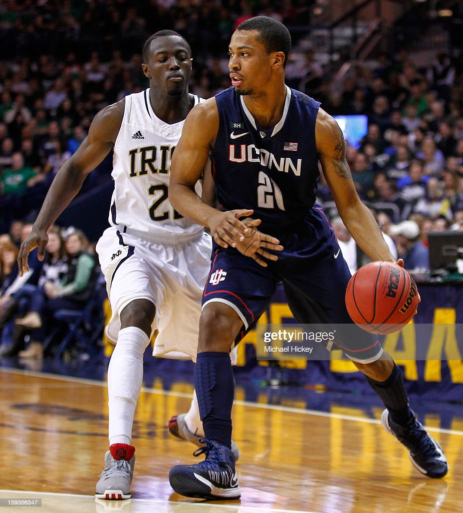 Omar Calhoun #21 of the Connecticut Huskies dribbles past Jerian Grant #22 of the Notre Dame Fighting Irish at Purcel Pavilion on January 12, 2013 in South Bend, Indiana. Connecticut defeated Notre Dame 65-58.
