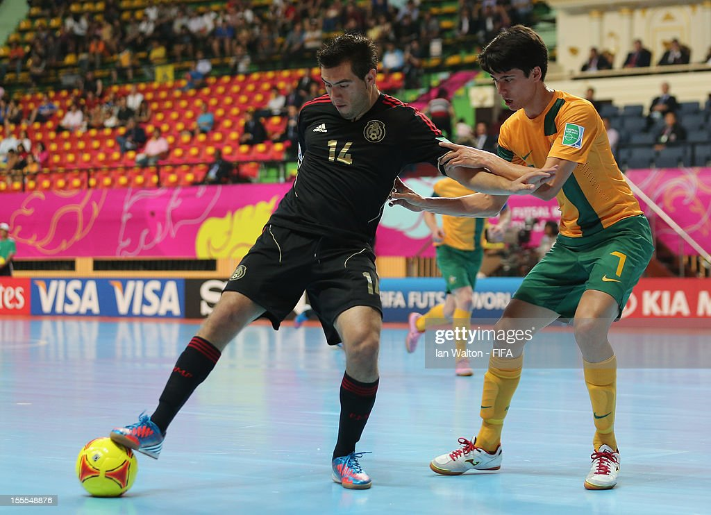 Omar Cervantes of Mexico shields the ball from Tobias Seeto (R) of Australia during the FIFA Futsal World Cup Thailand 2012, Group D match between Australia and Mexico at Nimibutr Stadium on November 5, 2012 in Bangkok, Thailand.