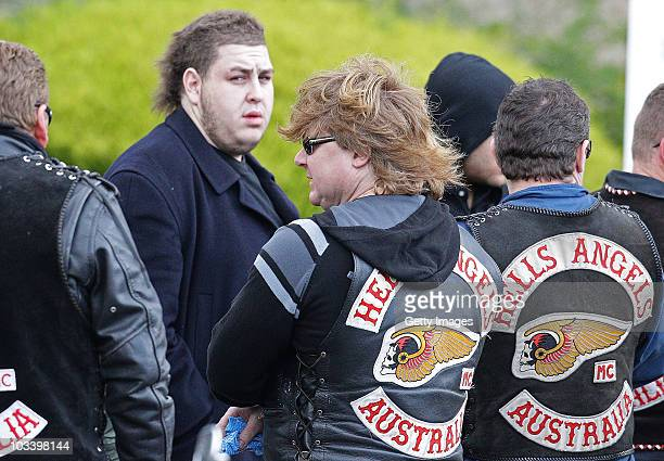 Omar Chaouk the son of Macchour Chaouk talks to Hells Angels bikies after the funeral for Melbourne crime figure Macchour Chaouk at Preston Mosque on...
