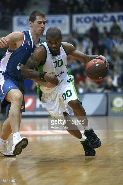 Omar Cook #00 of Unicaja competes with Davor Kus #5 of Cibona action during the Euroleague Basketball Game 9 match between Cibona Zagreb v Unicaja on...