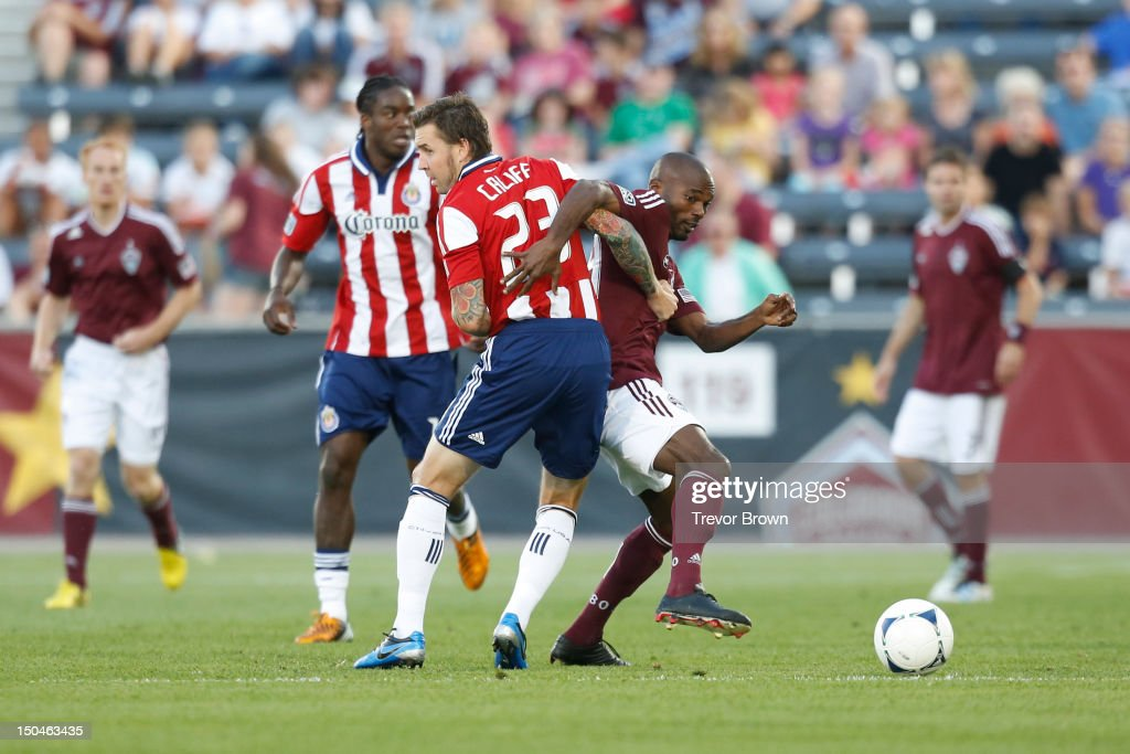 Omar Cummings of Colorado Rapids and Danny Califf of Chivas USA battle for possession of the ball during the first half of their MLS match at Dick's...