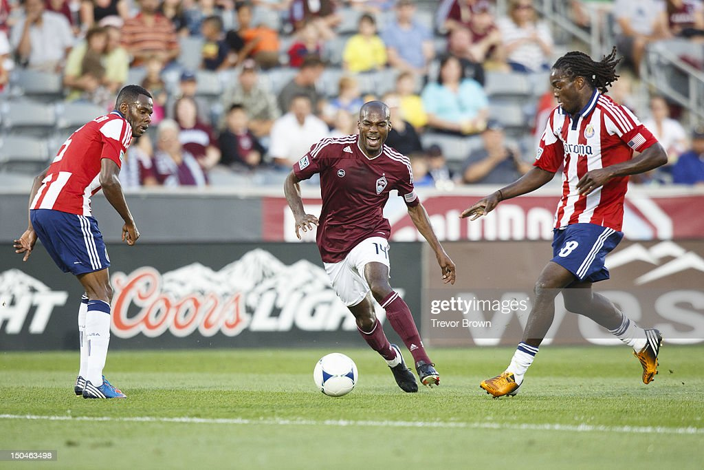 Omar Cummings of Colorado Rapids and Sharlie Joseph of Chivas USA battle for possession of the ball during their MLS match at Dick's Sporting Goods...