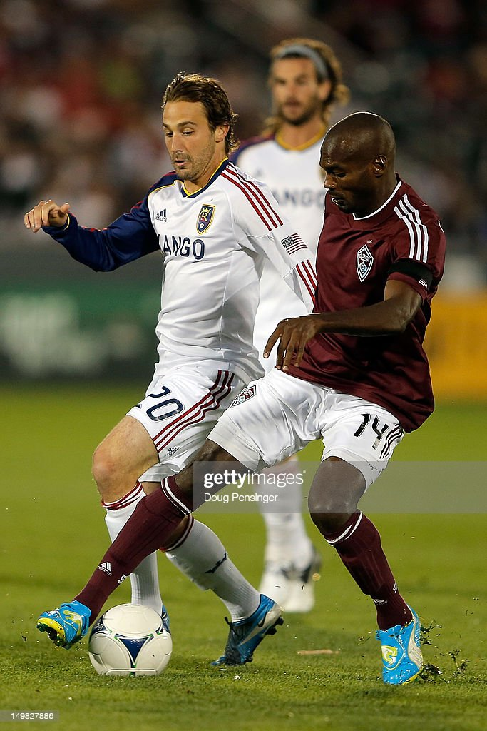 Omar Cummings of Colorado Rapids controls the ball against Ned Grabavoy of Real Salt Lake at Dick's Sporting Goods Park on August 4 2012 in Commerce...
