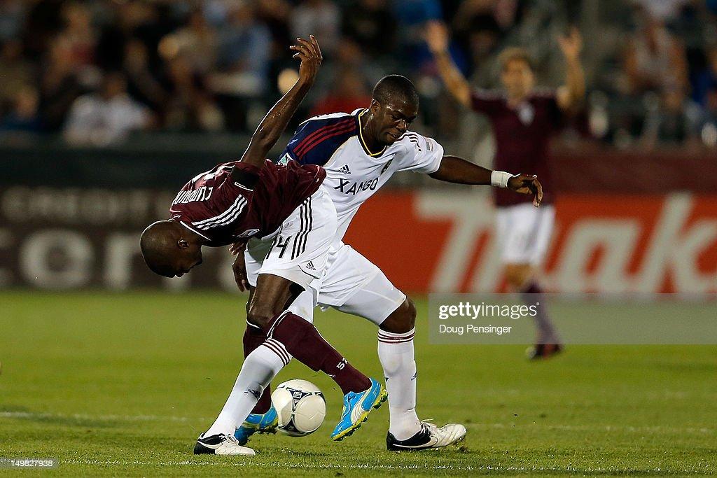 Omar Cummings of Colorado Rapids is fouled by Kwame WatsonSiriboe of Real Salt Lake at Dick's Sporting Goods Park on August 4 2012 in Commerce City...