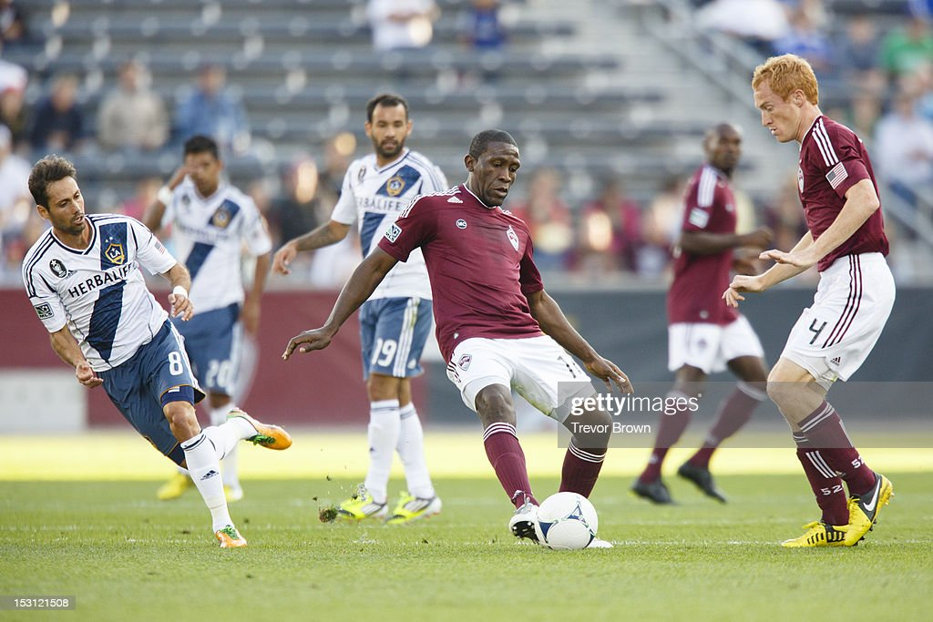 Omar Cummings of Colorado Rapids passes the ball to teammate Jeff Larentowicz during their MLS match against Los Angeles Galaxy at Dick's Sporting...
