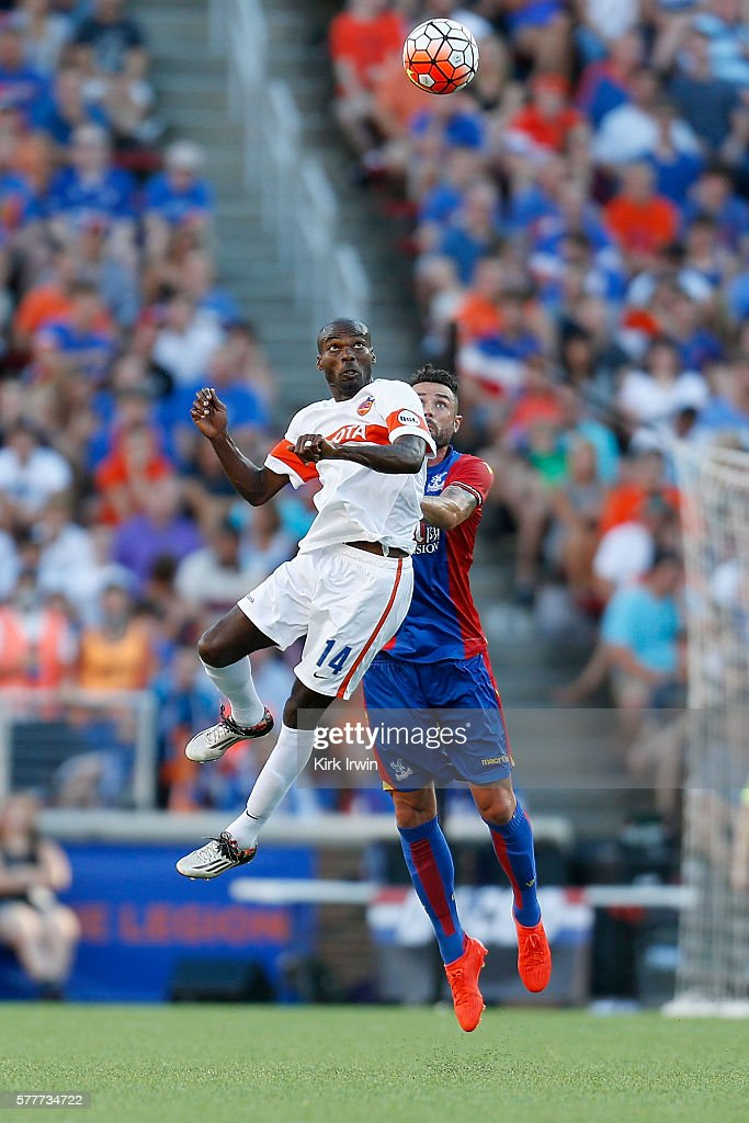 Omar Cummings of FC Cincinnati and Damien Delaney of Crystal Palace FC compete for a loose ball during the match at Nippert Stadium on July 16 2016...