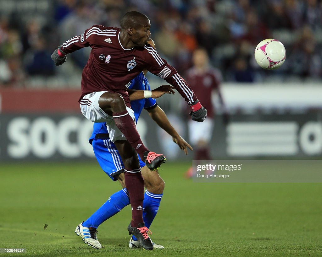 Omar Cummings of the Colorado Rapids controls the ball against Justin Morrow of the San Jose Earthquakes at Dick's Sporting Goods Park on October 6...