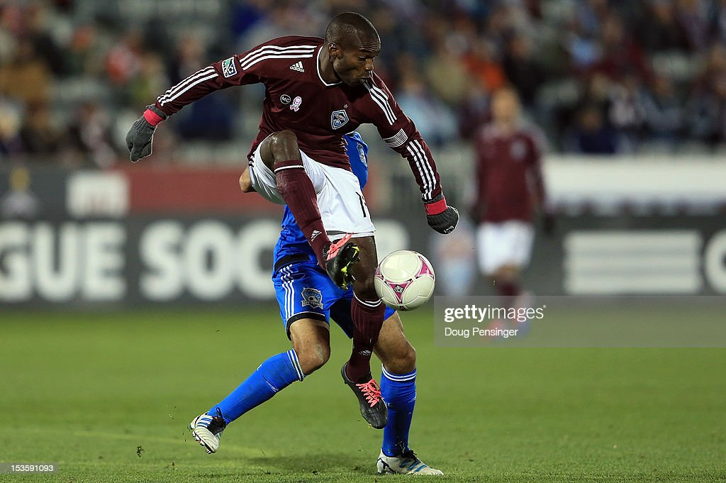Omar Cummings of the Colorado Rapids controls the ball against Sam Garza of the San Jose Earthquakes at Dick's Sporting Goods Park on October 6 2012...