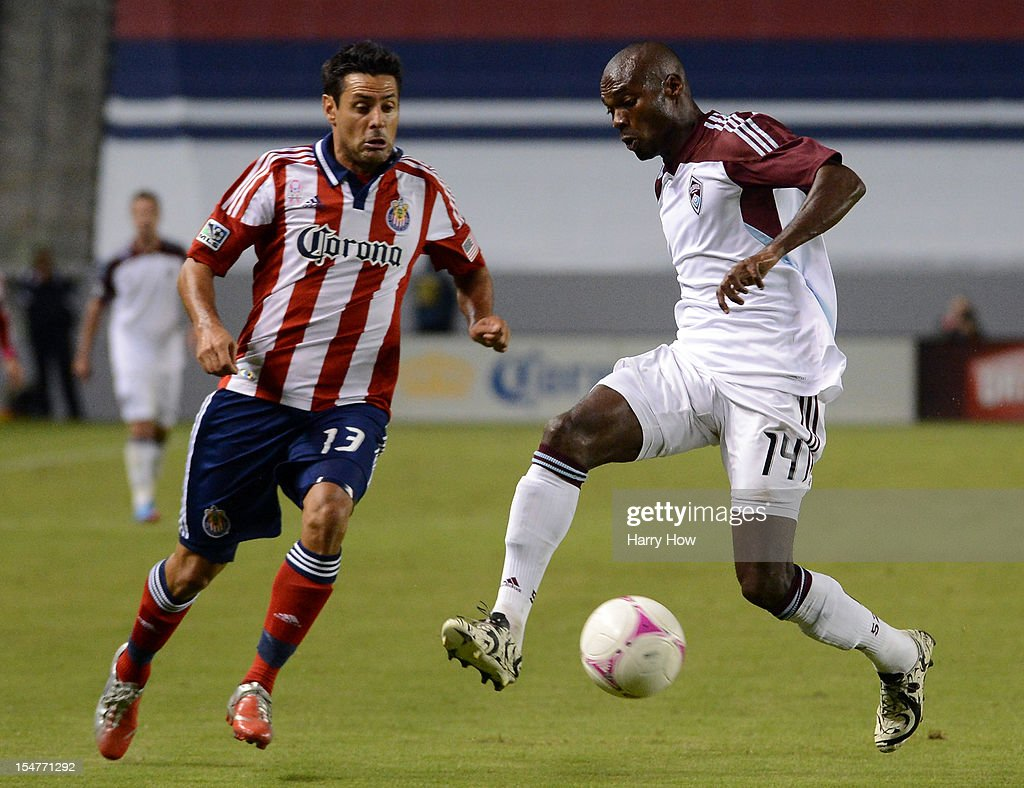 Omar Cummings of the Colorado Rapids controls the ball in front of Ante Jazic of Chivas USA at The Home Depot Center on October 20 2012 in Carson...