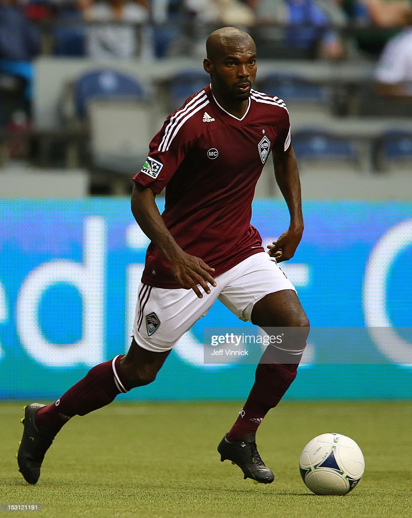 Omar Cummings of the Colorado Rapids dribbles the ball up field during their MLS game against the Vancouver Whitecaps FC September 23 2012 at BC...