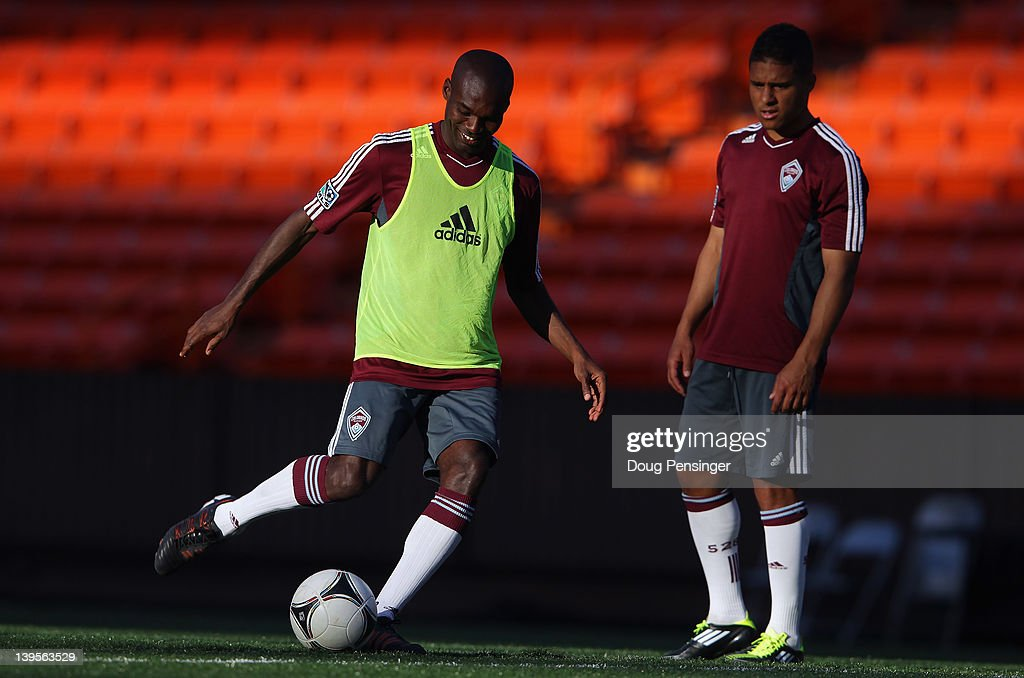 <a gi-track='captionPersonalityLinkClicked' href=/galleries/search?phrase=Omar+Cummings&family=editorial&specificpeople=4327657 ng-click='$event.stopPropagation()'>Omar Cummings</a> #14 of the Colorado Rapids takes a shot at the goal crossbar as Quincy Amarikwa #12 watches during a skills competition during a training session at the Aloha Stadium on February 22, 2012 in Honolulu, Hawaii. The Rapids are preparing for the Hawaiian Islands Invitational Soccer Tournament.