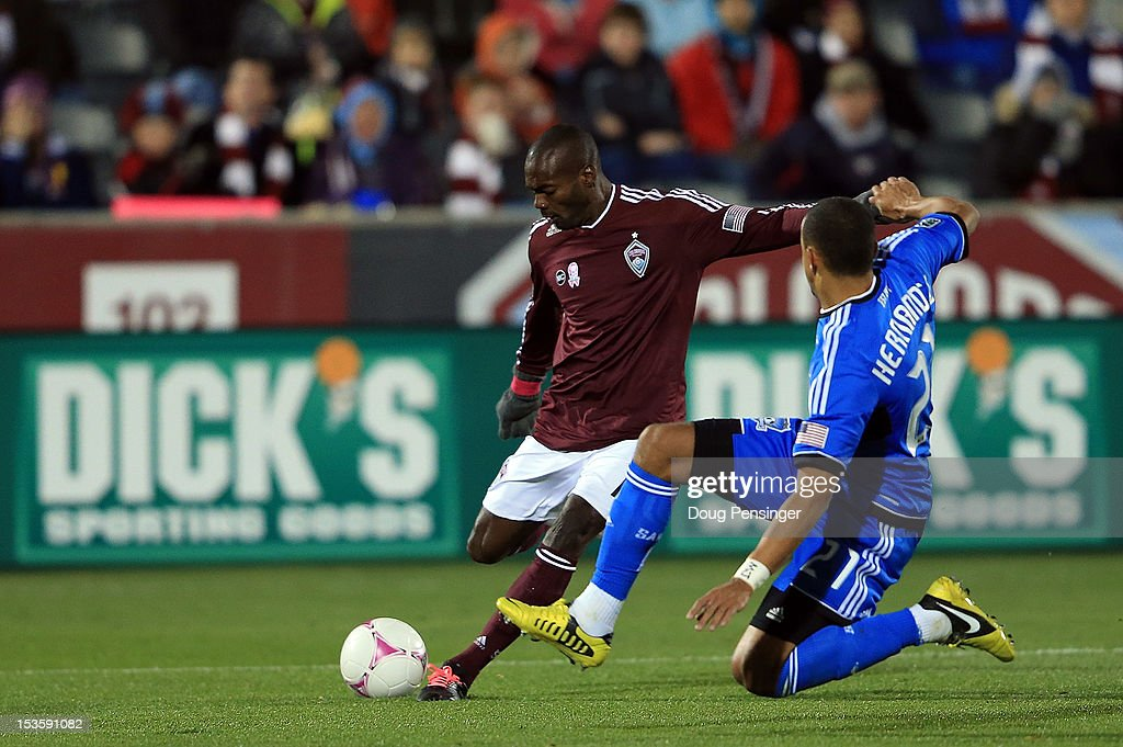 Omar Cummings of the Colorado Rapids takes a shot on goal against Jason Hernandez of the San Jose Earthquakes at Dick's Sporting Goods Park on...