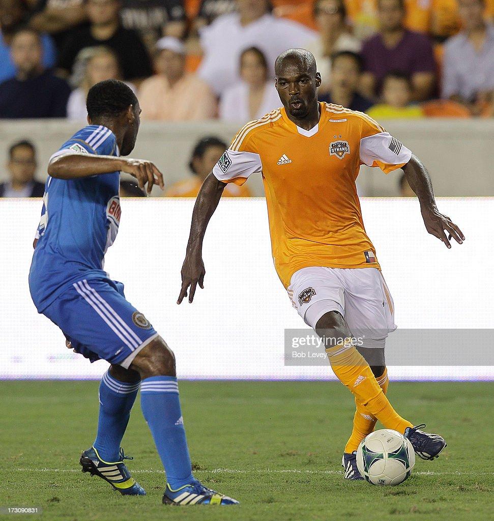 Omar Cummings of the Houston Dynamo looks to make a move on Amobi Okugo of the Philadelphia Union in the second half at BBVA Compass Stadium on July...