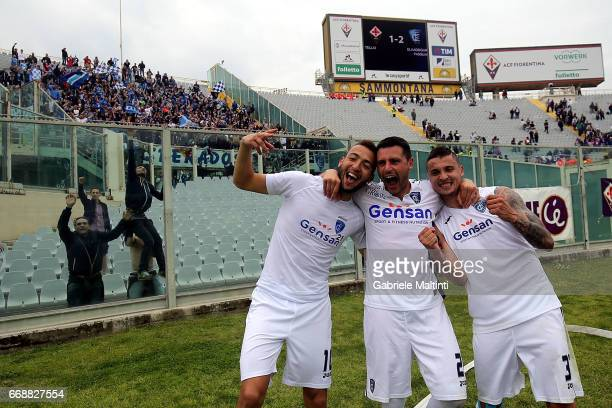 Omar El Kaddouri and Frederic Veseli and Rade Krunic of Empoli FC celebrates the victory after during the Serie A match between ACF Fiorentina and...