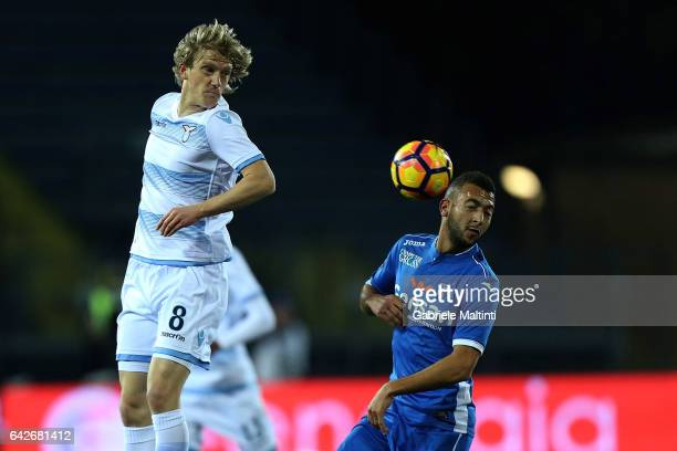 Omar EL Kaddouri of Empoli FC battles for the ball with Dusan Basta of SS Lazio during the Serie A match between Empoli FC and SS Lazio at Stadio...