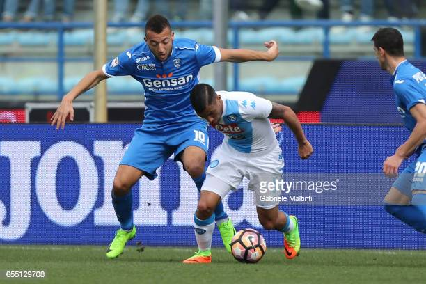 Omar El Kaddouri of Empoli Fc battles for the ball with Loureiro Allan of SSC Napoli during the Serie A match between Empoli FC and SSC Napoli at...