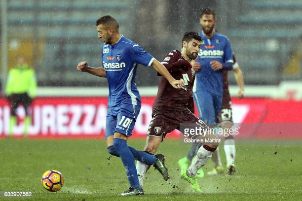 Omar El Kaddouri of Empoli FC battles for the ball with Marco Benassi of FC Torino during the Serie A match between Empoli FC and FC Torino at Stadio...