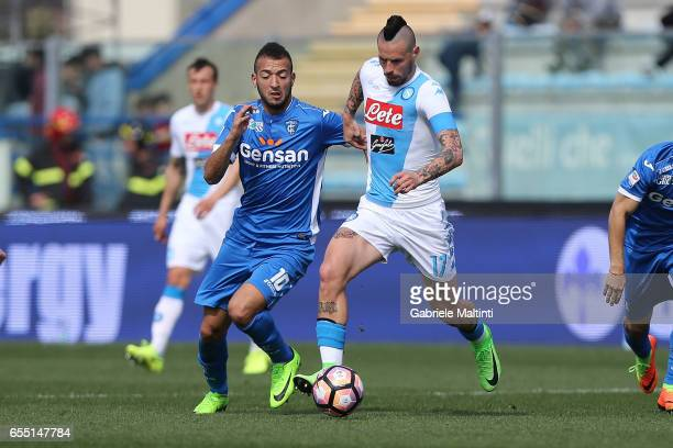 Omar El Kaddouri of Empoli Fc battles for the ball with Marek Hamsik of SSC Napoli during the Serie A match between Empoli FC and SSC Napoli at...