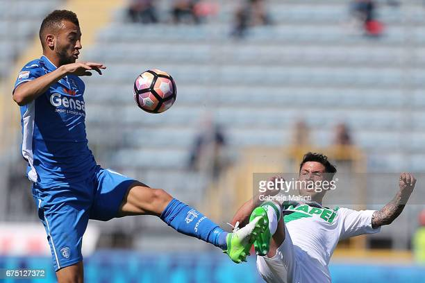 Omar El Kaddouri of Empoli FC battles for the ball with Stefano Sensi of US Sassuolo during the Serie A match between Empoli FC and US Sassuolo at...