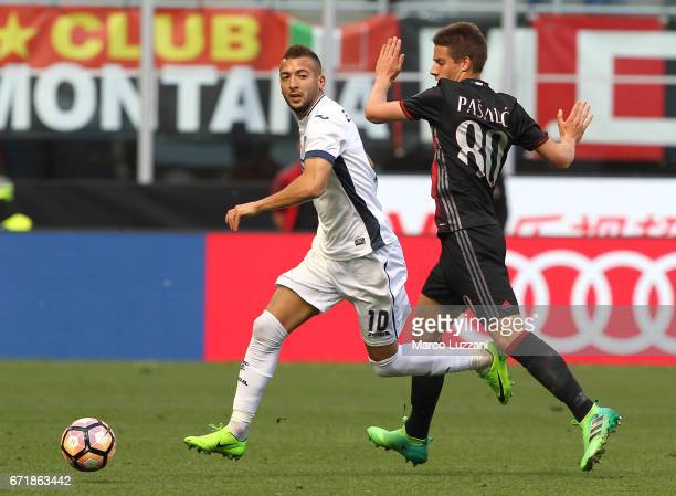 Omar El Kaddouri of Empoli FC competes for the ball with Mario Pasalic of AC Milan during the Serie A match between AC Milan and Empoli FC at Stadio...