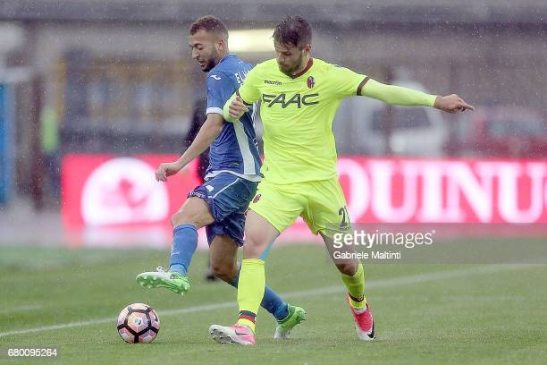 Omar El Kaddouri of Empoli FC in action against Bruno Petkovic of Bologna FC during the Serie A match between Empoli FC and Bologna FC at Stadio...