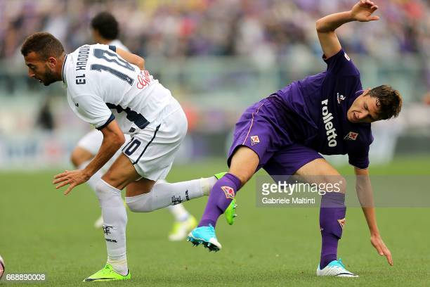 Omar El Kaddouri of Empoli FC in action against Federico Chiesa oc ACF Fiorentina during the Serie A match between ACF Fiorentina and Empoli FC at...