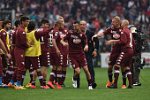 Omar El Kaddouri of Torino FC celebrates victory with team mates at the end of the Serie A match between Torino FC and Juventus FC at Stadio Olimpico...