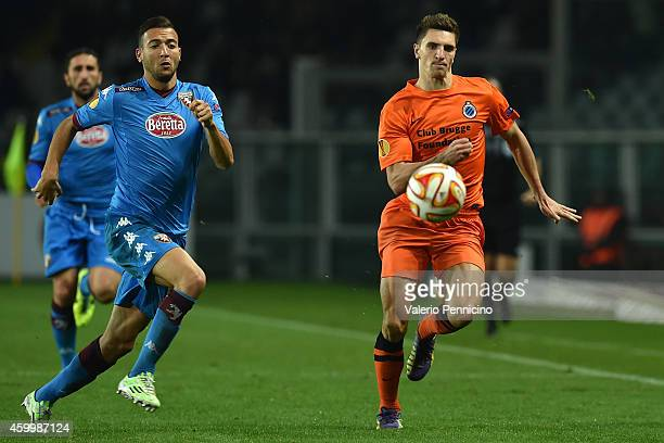 Omar El Kaddouri of Torino FC competes with Thomas Meunier of Club Brugge KV during the UEFA Europa League group B match between Torino FC and Club...