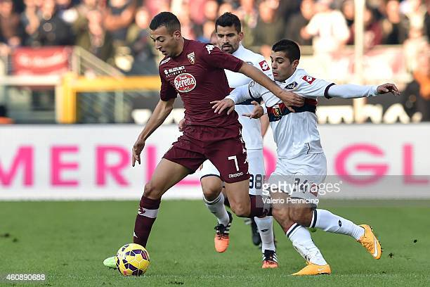 Omar El Kaddouri of Torino FC is challenged by Iago Falque of Genoa CFC during the Serie A match betweeen Torino FC and Genoa CFC at Stadio Olimpico...
