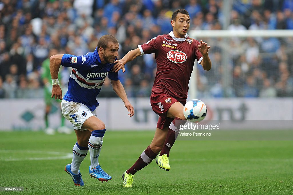 Omar El Kaddouri (R) of Torino FC is challenged by <a gi-track='captionPersonalityLinkClicked' href=/galleries/search?phrase=Lorenzo+De+Silvestri&family=editorial&specificpeople=4533237 ng-click='$event.stopPropagation()'>Lorenzo De Silvestri</a> (L) of UC Sampdoria during the Serie A match between UC Sampdoria and Torino FC at Stadio Luigi Ferraris on October 6, 2013 in Genoa, Italy.