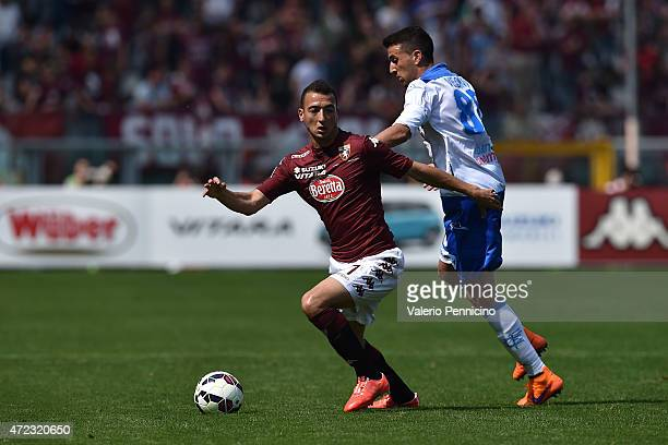 Omar El Kaddouri of Torino FC is challenged by Matias Vecino of Empoli FC during the Serie A match between Torino FC and Empoli FC at Stadio Olimpico...