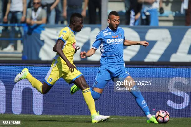 Omar El Kadoouri of Empoli Fc battles for the ball with Mamadou Coulibaly of Pescara Calcio during the Serie A match between Empoli FC and Pescara...