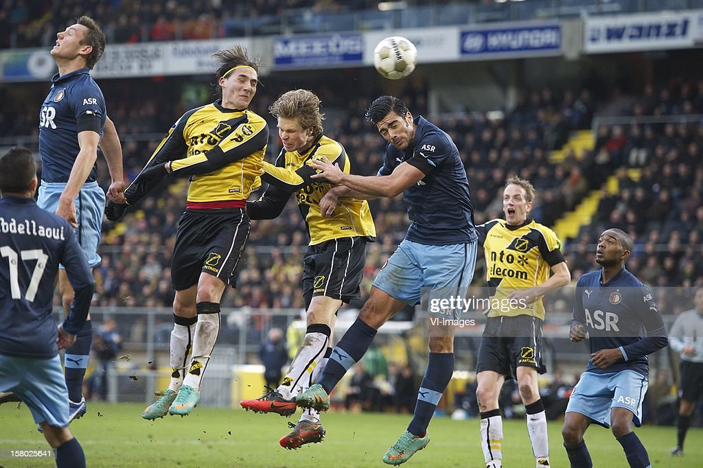 Omar Elabdellaoui of Feyenoord, Stefan de Vrij of Feyenoord, <a gi-track='captionPersonalityLinkClicked' href=/galleries/search?phrase=Nemanja+Gudelj&family=editorial&specificpeople=7480325 ng-click='$event.stopPropagation()'>Nemanja Gudelj</a> of NAC Breda, Kees Luijckx of NAC Breda, Graziano Pelle of Feyenoord, Mark Looms of NAC Breda, Miquel Nelom of Feyenoord during the Dutch Eredivisie match between NAC Breda and Feyenoord at the Rat Verlegh Stadium on December 09, 2012 in Breda, The Netherlands.