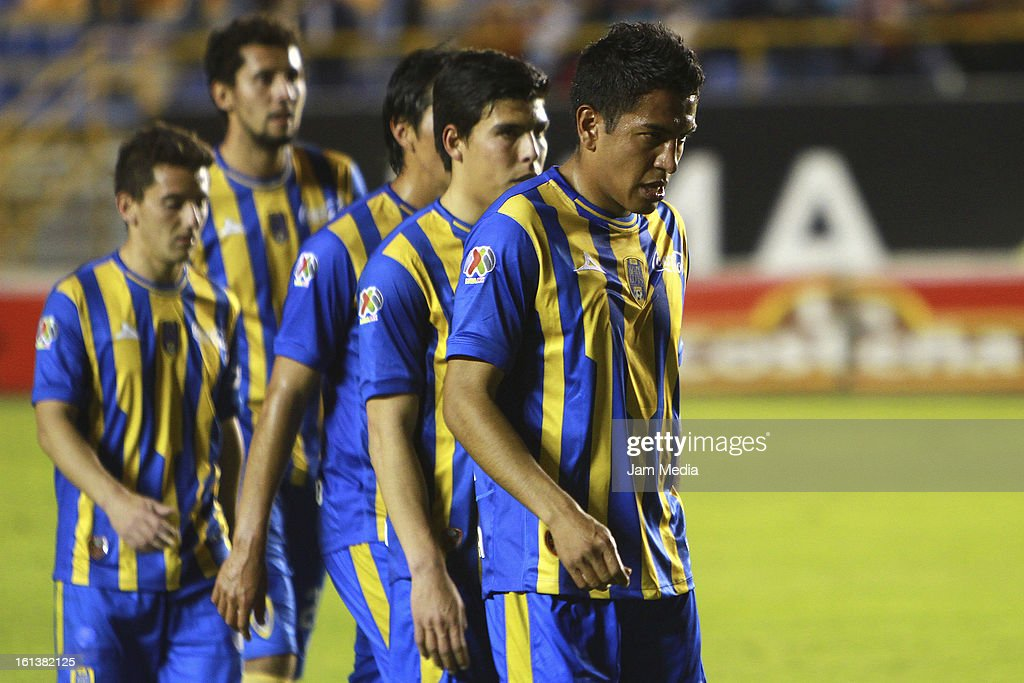 Omar Esparza (R) of San Luis reacts during a match between San Luis and Puebla as part of the Clausura 2013 Liga MX at Alfonso Lastras Stadium on February 09, 2013 in San Luis Potosi, Mexico.