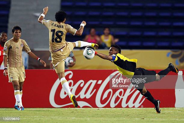 Omar Gaber of Egypt is challenged by goalkeeper Luis Mejia of Panama during the FIFA U20 World Cup Group E match between Egypt and Panama at Estadio...