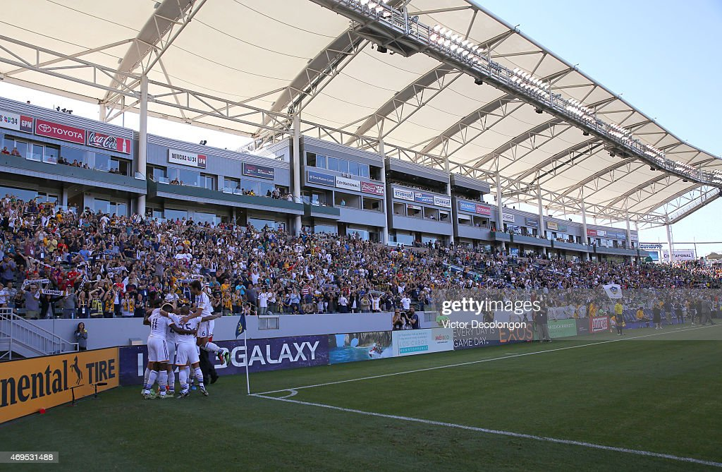 <a gi-track='captionPersonalityLinkClicked' href=/galleries/search?phrase=Omar+Gonzalez&family=editorial&specificpeople=2488485 ng-click='$event.stopPropagation()'>Omar Gonzalez</a> #4, Gyasi Zardes #11, Stefan Ishizaki #24, Rafael Garcia #25 and Baggio Husidic #6 of Los Angeles Galaxy celebrate with teammate <a gi-track='captionPersonalityLinkClicked' href=/galleries/search?phrase=Alan+Gordon+-+Voetballer&family=editorial&specificpeople=11667134 ng-click='$event.stopPropagation()'>Alan Gordon</a> #9 after Gordon scored a goal in the first half against the Seattle Sounders FC in the MLS match at StubHub Center on April 12, 2015 in Los Angeles, California. The Galaxy defeated the Sounders 1-0.