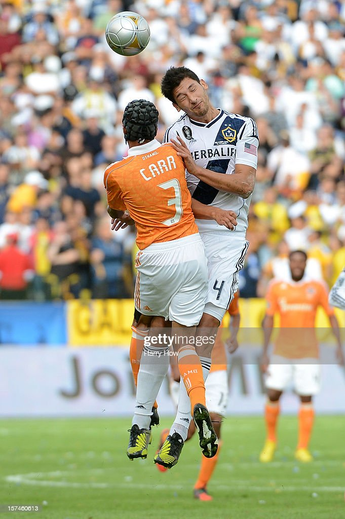 Omar Gonzalez of Los Angeles Galaxy and Calen Carr of Houston Dynamo go for a header in the 2012 MLS Cup at The Home Depot Center on December 1 2012...