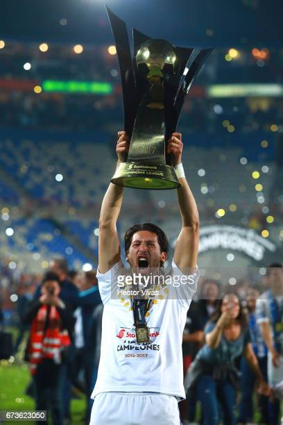 Omar Gonzalez of Pachuca lifts the trophy to celebrate after winning the Final second leg match between Pachuca and Tigres UANL as part of the...