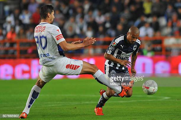 Omar Gonzalez of Pachuca vies for the ball with Carlos Sanchez of Monterrey during the Mexican Clausura 2016 Tournament at the Hidalgo stadium on...