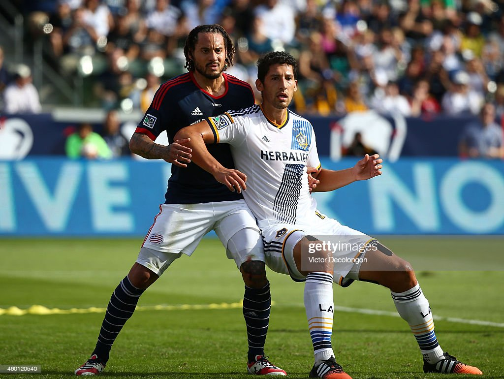 Omar Gonzalez of the Los Angeles Galaxy and Jermaine Jones of the New England Revolution vie for position prior to a corner kick in the first half...