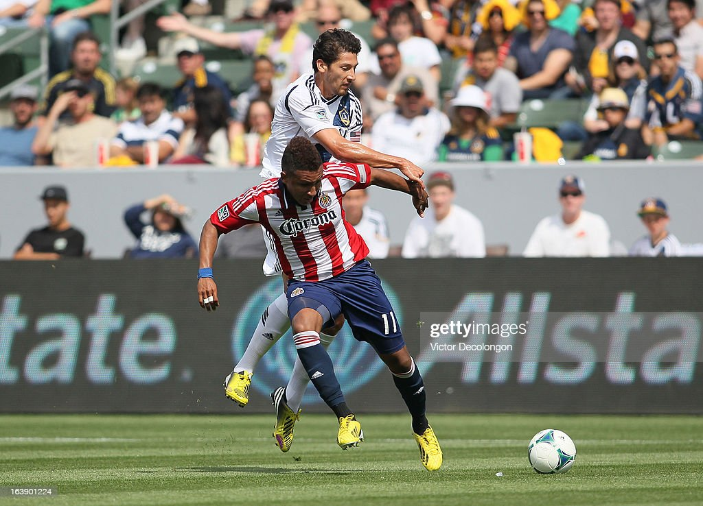 <a gi-track='captionPersonalityLinkClicked' href=/galleries/search?phrase=Omar+Gonzalez&family=editorial&specificpeople=2488485 ng-click='$event.stopPropagation()'>Omar Gonzalez</a> #4 of the Los Angeles Galaxy and <a gi-track='captionPersonalityLinkClicked' href=/galleries/search?phrase=Juan+Agudelo&family=editorial&specificpeople=6850559 ng-click='$event.stopPropagation()'>Juan Agudelo</a> #11 of Chivas USA vie for the ball during their MLS match at The Home Depot Center on March 17, 2013 in Carson, California. Chivas USA and the Los Angeles Galaxy played to a 1-1 draw.