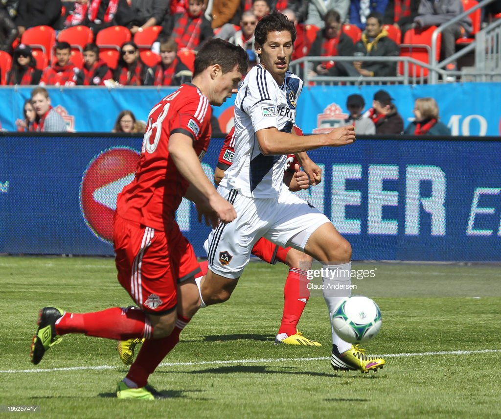 Omar Gonzalez #4 of the Los Angeles Galaxy defends against Darren O'Dea #48 of Toronto FC in an MLS game on March 30, 2013 at BMO field in Toronto, Ontario, Canada. The LA Galaxy and the Toronto FC played to a 2-2 tie.