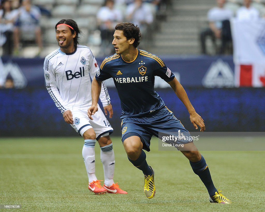 <a gi-track='captionPersonalityLinkClicked' href=/galleries/search?phrase=Omar+Gonzalez&family=editorial&specificpeople=2488485 ng-click='$event.stopPropagation()'>Omar Gonzalez</a> #4 of the Los Angeles Galaxy in action against the Vancouver Whitecaps during an MLS Game at B.C. Place on May 11, 2013 in Vancouver, British Columbia, Canada.