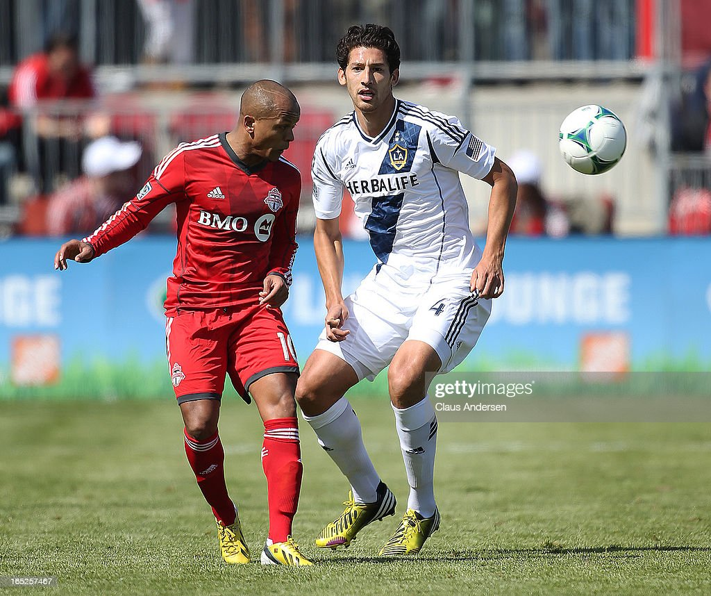 Omar Gonzalez #4 of the Los Angeles Galaxy keeps an eye on Robert Earnshaw #10 of Toronto FC in an MLS game on March 30, 2013 at BMO field in Toronto, Ontario, Canada. The LA Galaxy and the Toronto FC played to a 2-2 tie.