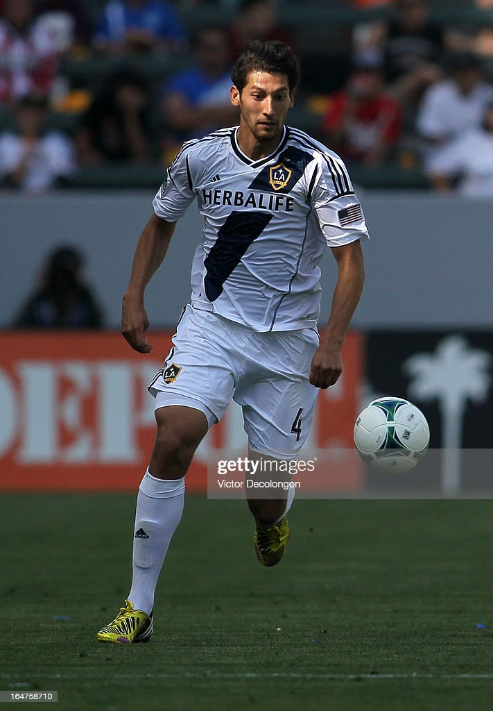 Omar Gonzalez #4 of the Los Angeles Galaxy paces the ball on the attack against Chivas USA in the second half of their MLS match at The Home Depot Center on March 17, 2013 in Carson, California. Chivas USA and the Los Angeles Galaxy played to a 1-1 draw.