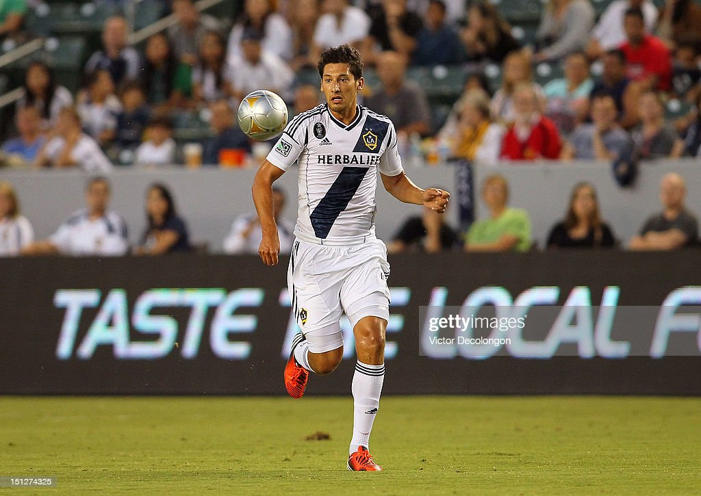 Omar Gonzalez #4 of the Los Angeles Galaxy pursues the ball during the MLS match against the Vancouver Whitecaps at The Home Depot Center on September 1, 2012 in Carson, California. The Galaxy defeated the Whitecaps 2-0.
