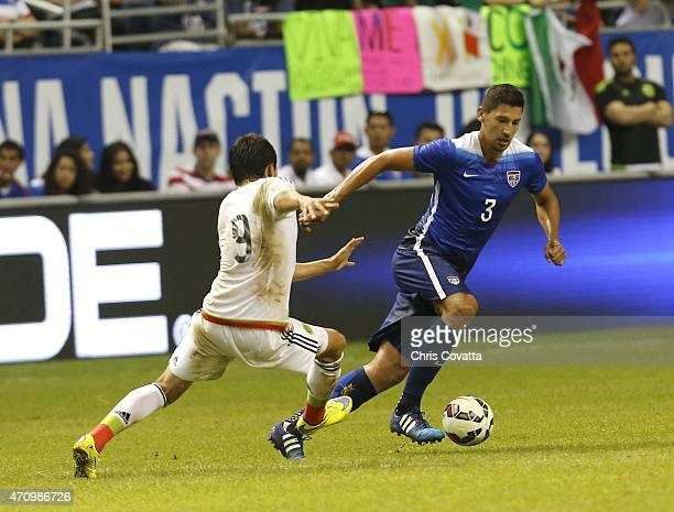 Omar Gonzalez of the United States advances the ball against Erick Torres of Mexico during an international friendly match at the Alamodome on April...