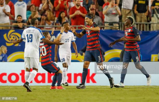 Omar Gonzalez of the United States celebrates his goal with Paul Arriola and Gyasi Zardes as Daniel Herelle of Martinique reacts during the second...