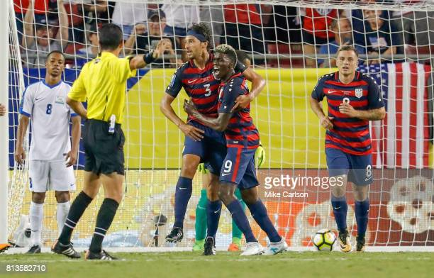 Omar Gonzalez of the United States celebrates his goal with teammate Gyasi Zardes as Jordan Morris looks on and Jordy Delem of Martinique reacts...